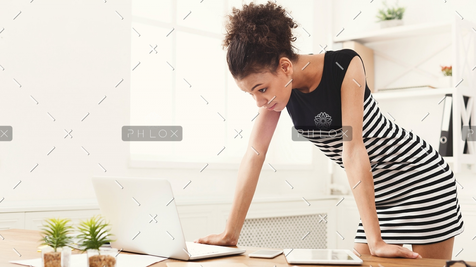 business-woman-working-on-laptop-at-office-PRFJKQJ-1