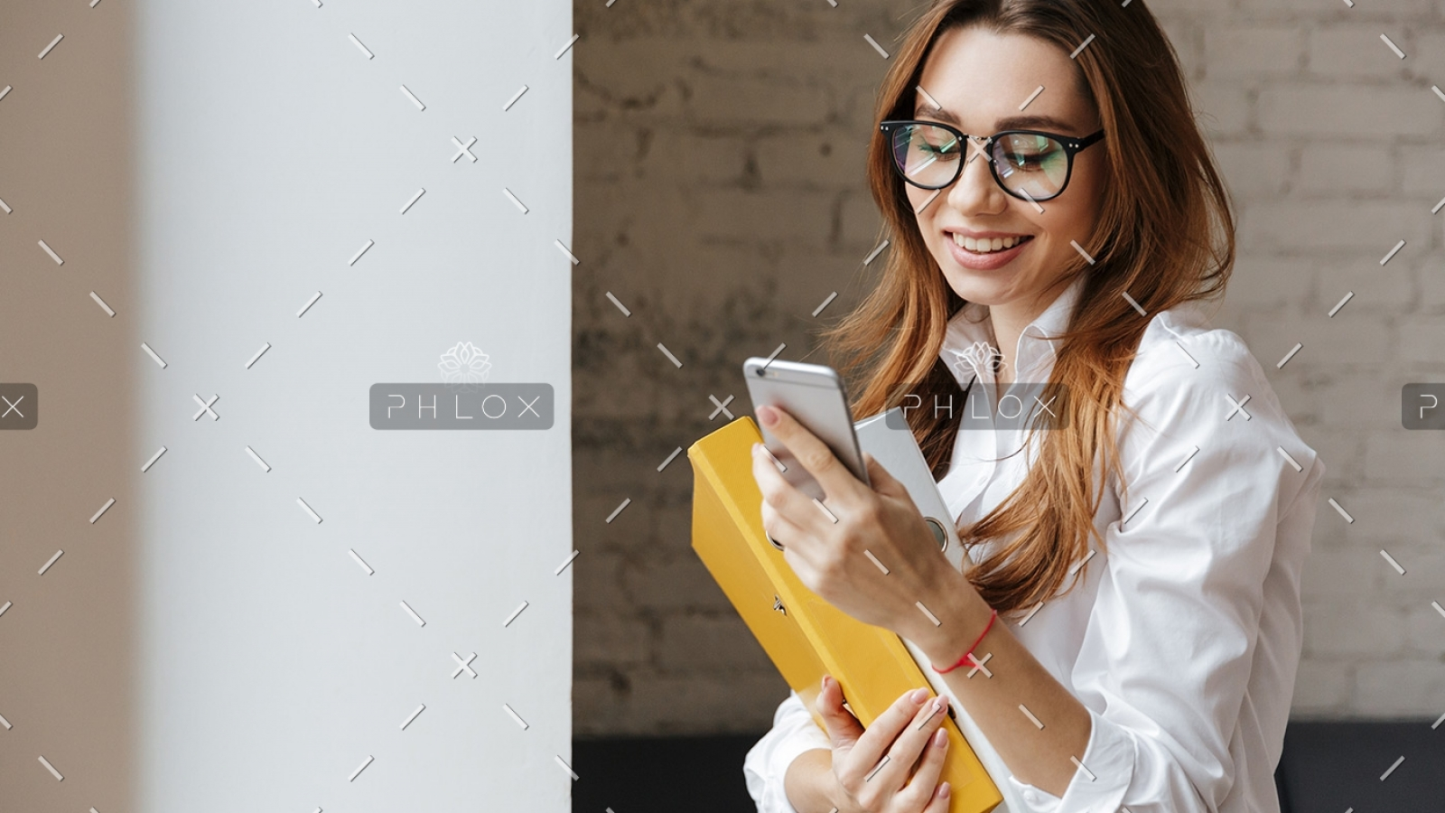 happy-business-woman-indoors-using-mobile-phone-P9WS3SD-1