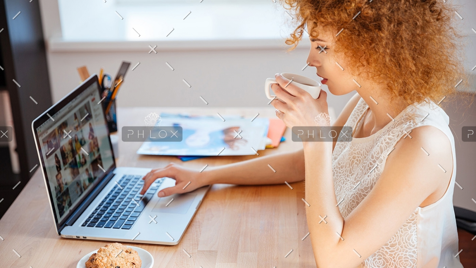 woman-photographer-drinking-coffee-and-working-PJNBP6U-1